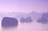 In Vietnamese ha long means 'descending dragon', and legend has it that Halong Bay was formed by a gigantic dragon which plunged into the Gulf of Tonkin, creating thousands of limestone outcrops by the lashing of its tail. Geologists tend to dismiss this theory, arguing that the myriad islands that dot Halong Bay and extend all the way north to the Chinese frontier are the product of selective erosion of the seabed over millennia.